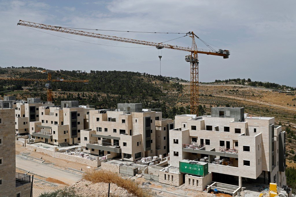 Buildings are under construction in the Jewish settlement of Gilo on 6 June (AFP)