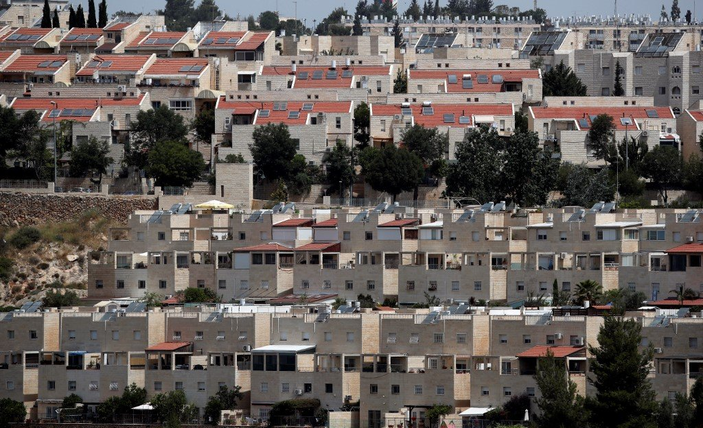 Buildings are under construction in a Jewish settlement in Jerusalem on 6 June (AFP)