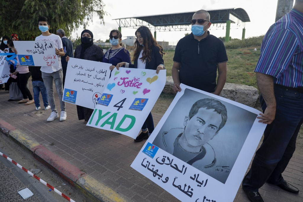 Demonstrators in Tayibe, Israel, protest the killing of Iyad al-Halak in June 2020 (AFP)