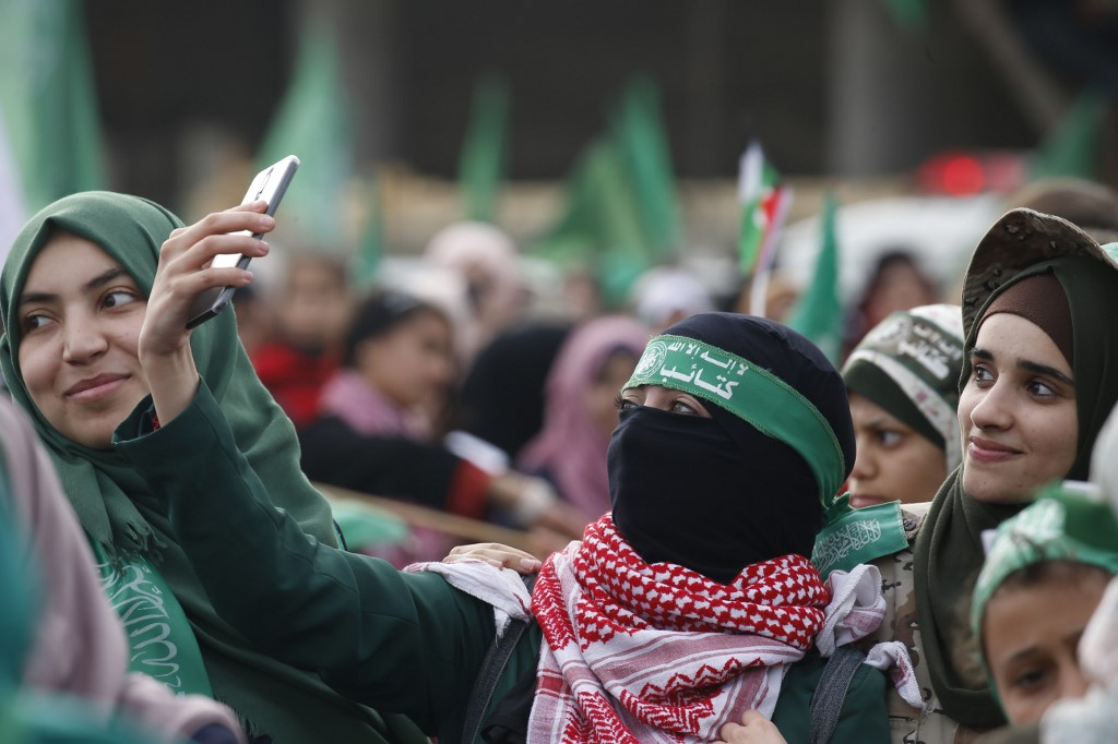 Palestinians attend a rally celebrating Hamas in Gaza City on 16 December (AFP)