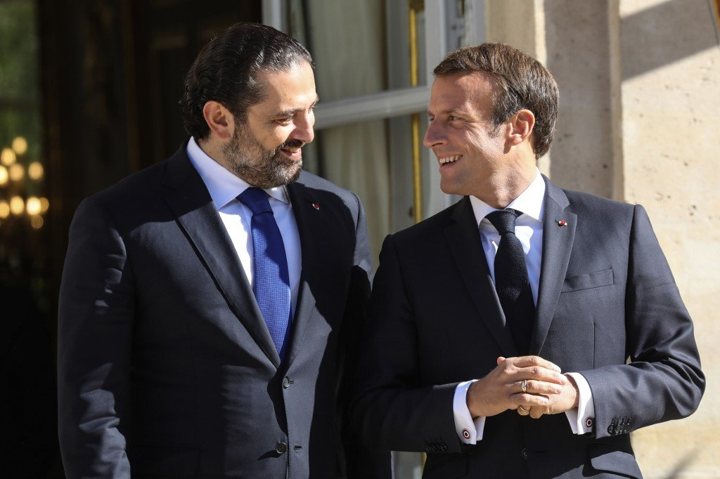 Lebanese Prime Minister Saad Hariri speaks with French President Emmanuel Macron in Paris in September 2019 (AFP)