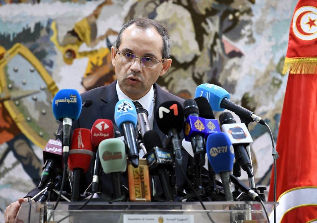 Tunisian Interior Minister Hichem Fourati speaking at a press conference in Tunis last year (AFP)