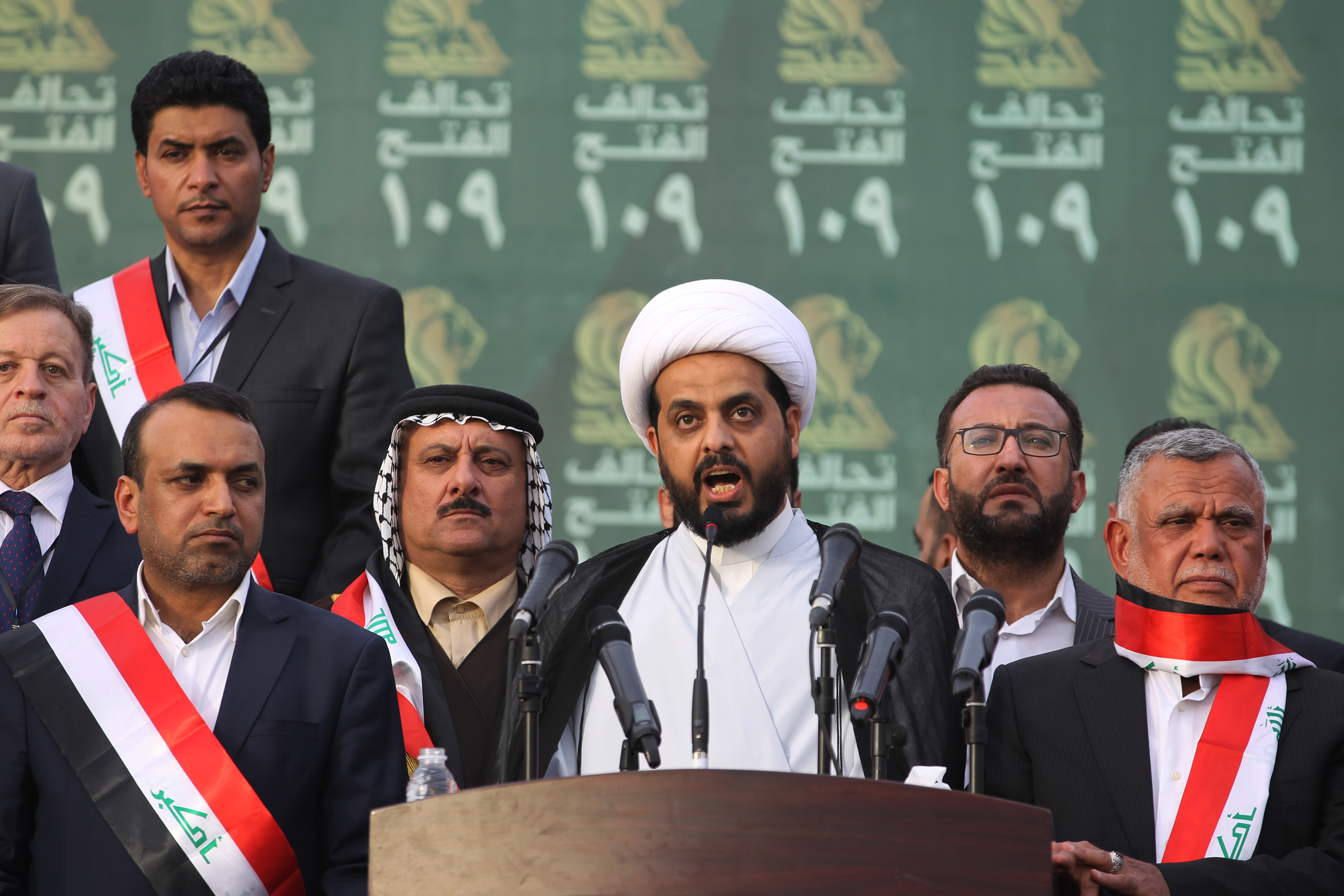 Qais al-Khazali, centre, leader of the Asa'ib Ahl al-Haq, gives a speech in Baghdad during a campaign rally for the Fateh Alliance, a coalition of Iranian-supported militia groups (AFP)