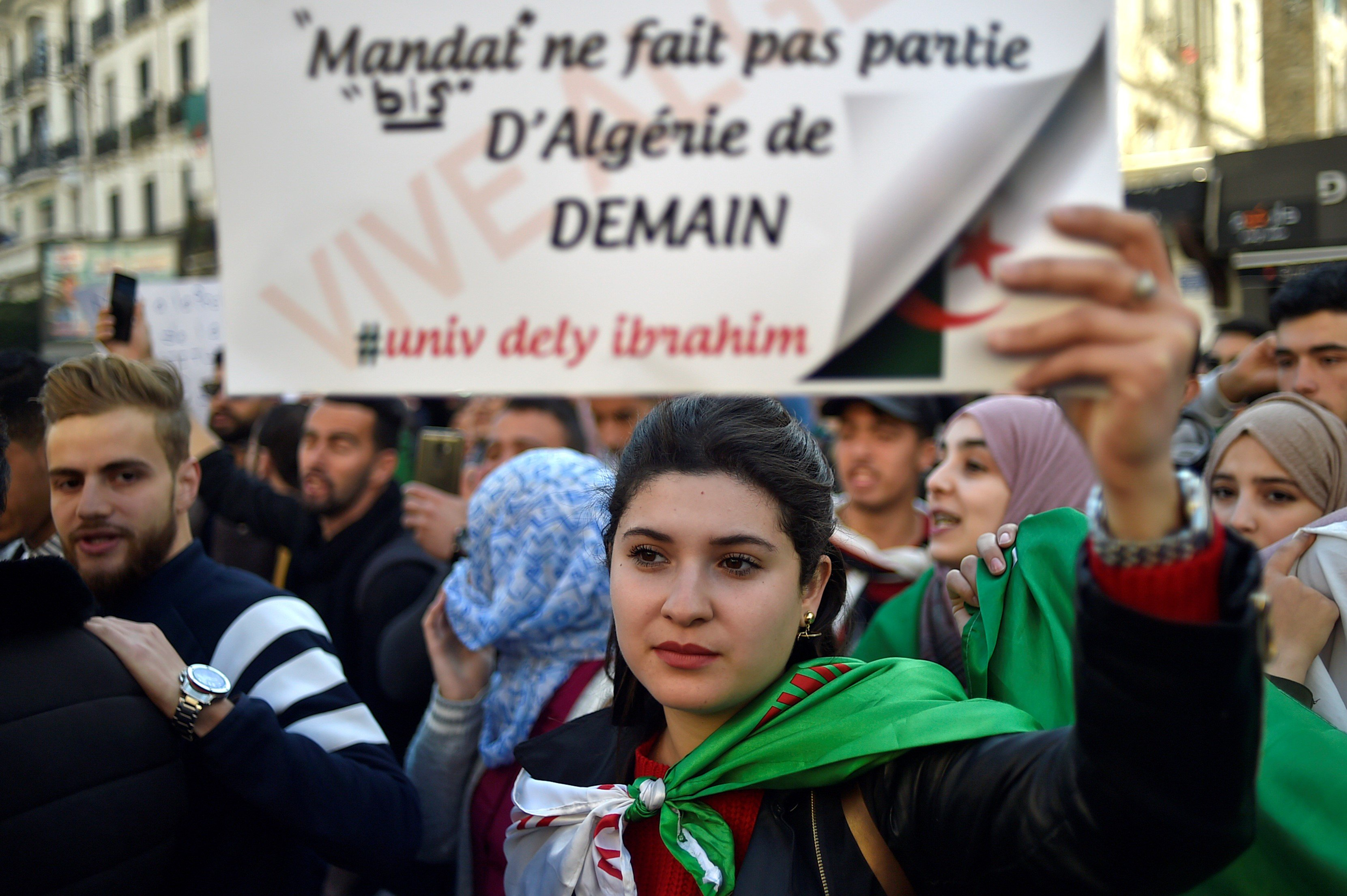 Algerian students demonstrate in the centre of the capital Algiers on March 12 (AFP)