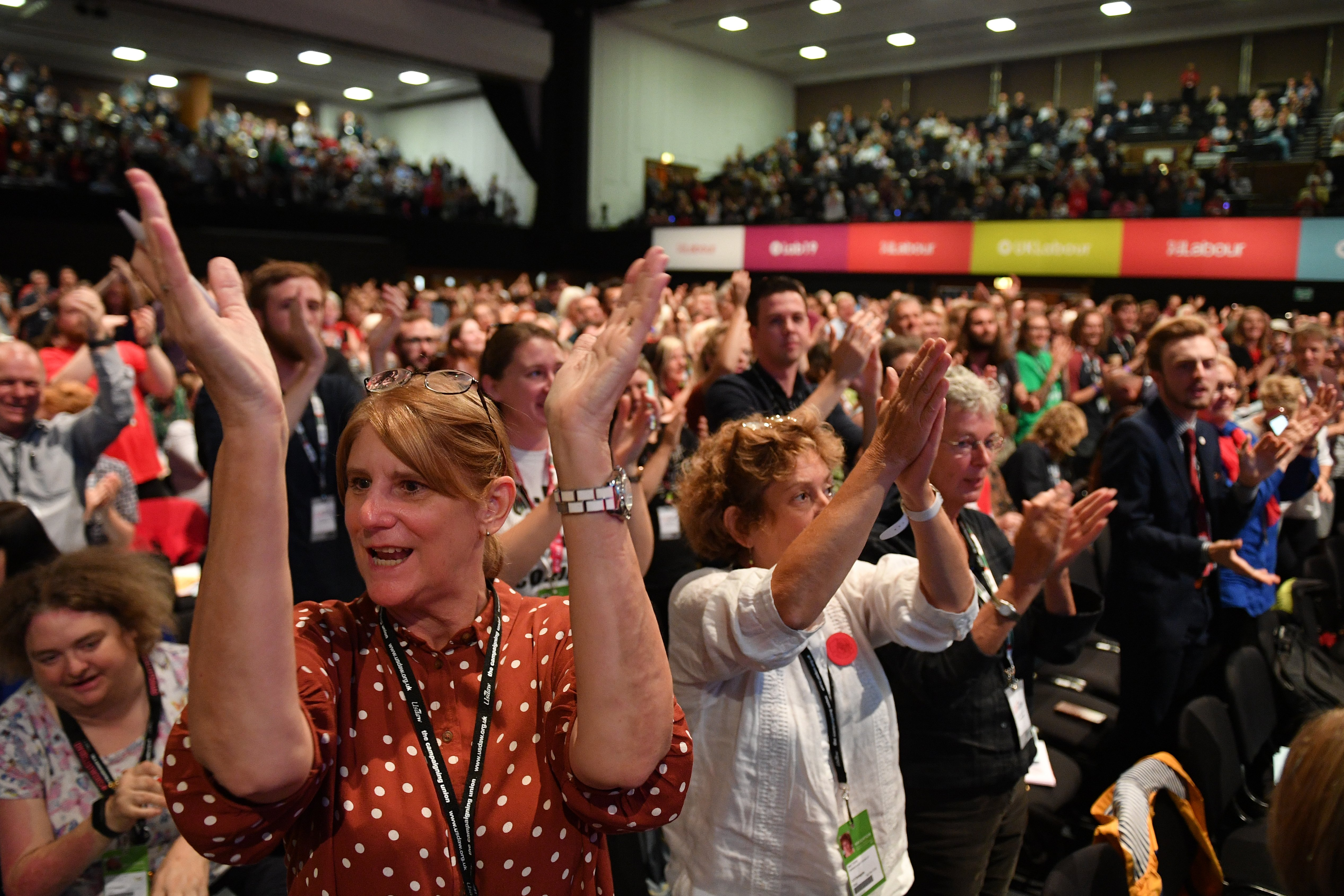 A standing ovation is given for Unite union general secretary Len McCluskey after he delivers a speech at the Labour party conference in Brighton (AFP)