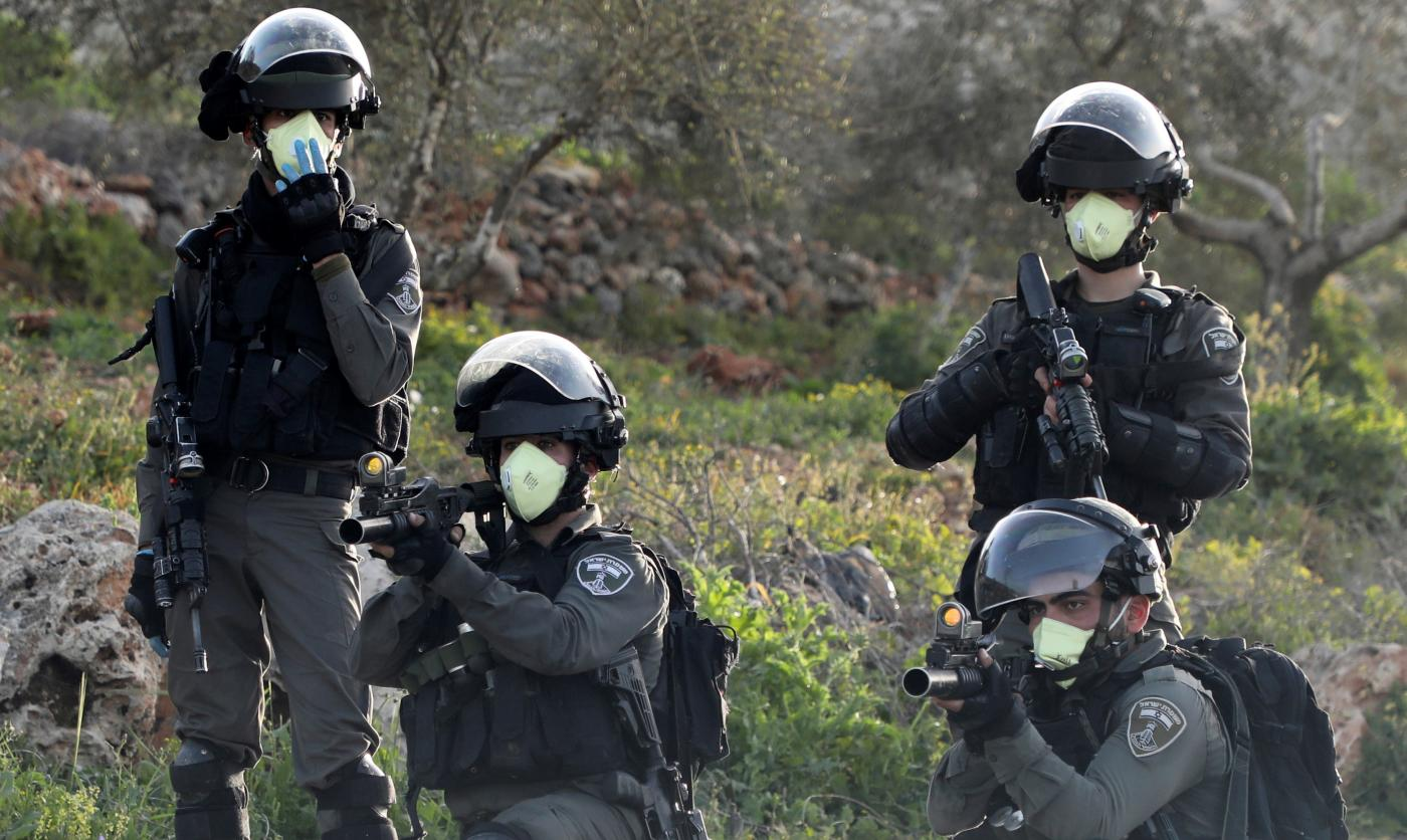 Israeli border guards aim their weapons in the occupied West Bank on 11 March (AFP)