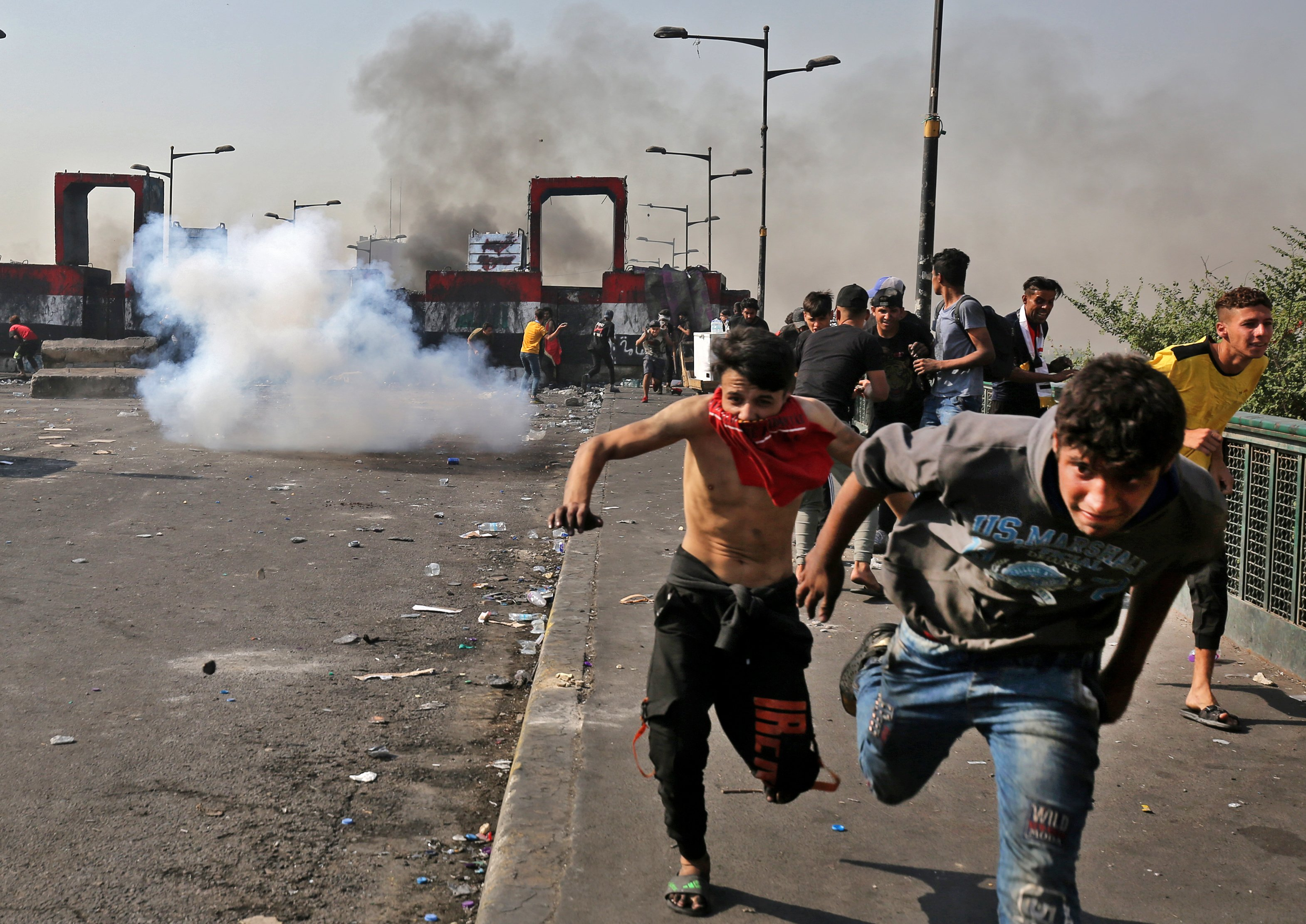 Clashes continue in Iraq on first anniversary of anti-government uprisings
