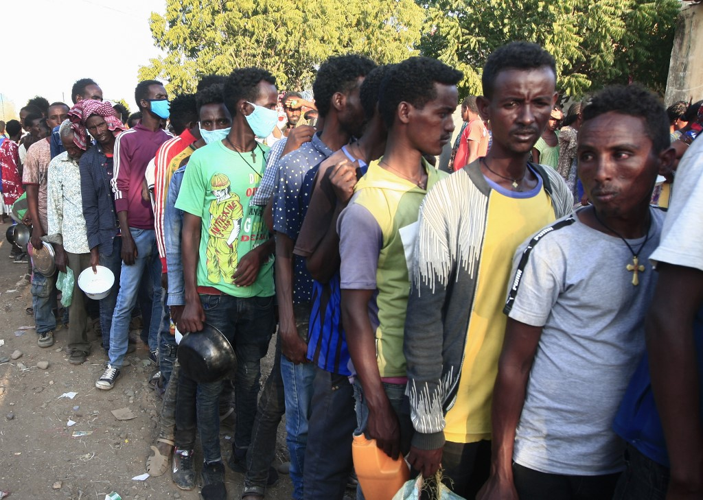 Ethiopians wait in line for food aid after fleeing the Tigray region in northern Ethiopia (AFP)