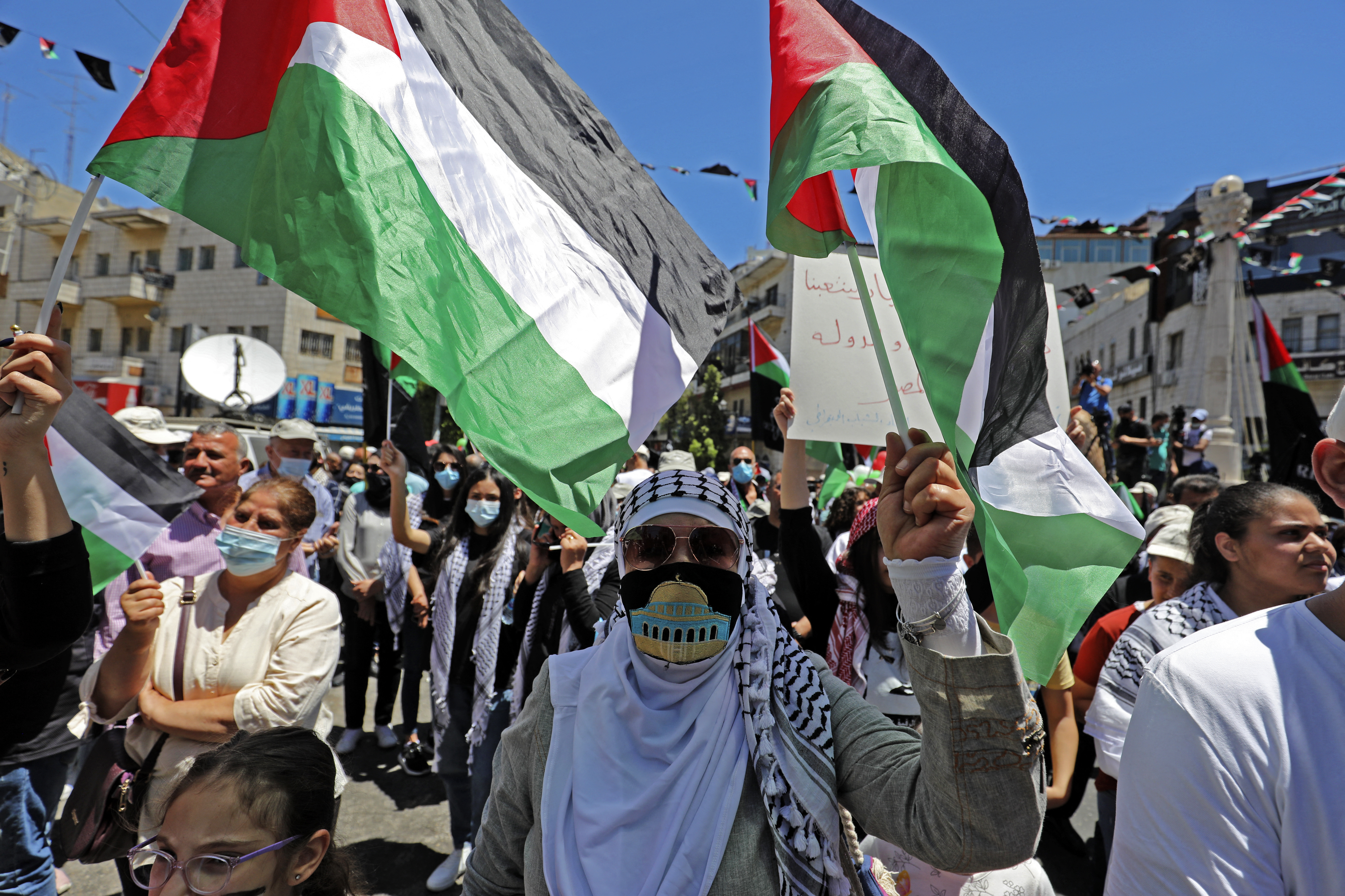 Palestinians protest in the occupied West Bank village of Salem on 15 May 2021 (AFP)