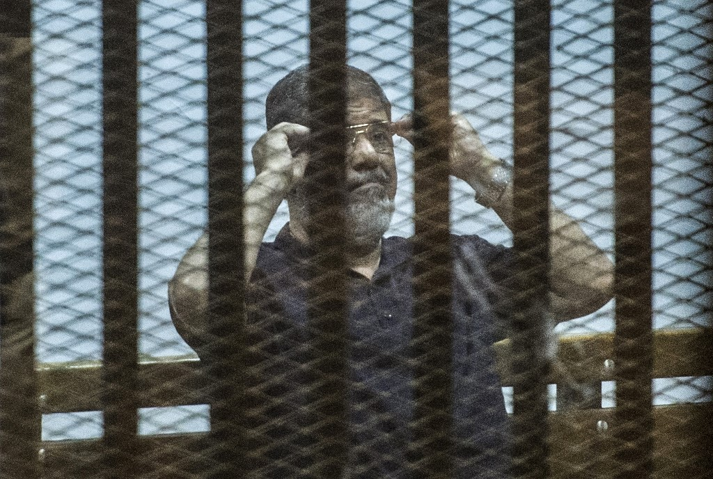 EXCLUSIVE: Egyptian officials threatened Morsi days before death