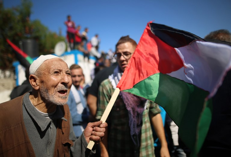 Protesters gather on the centenary of the Balfour Declaration in Gaza on 2 November 2017 (AFP)