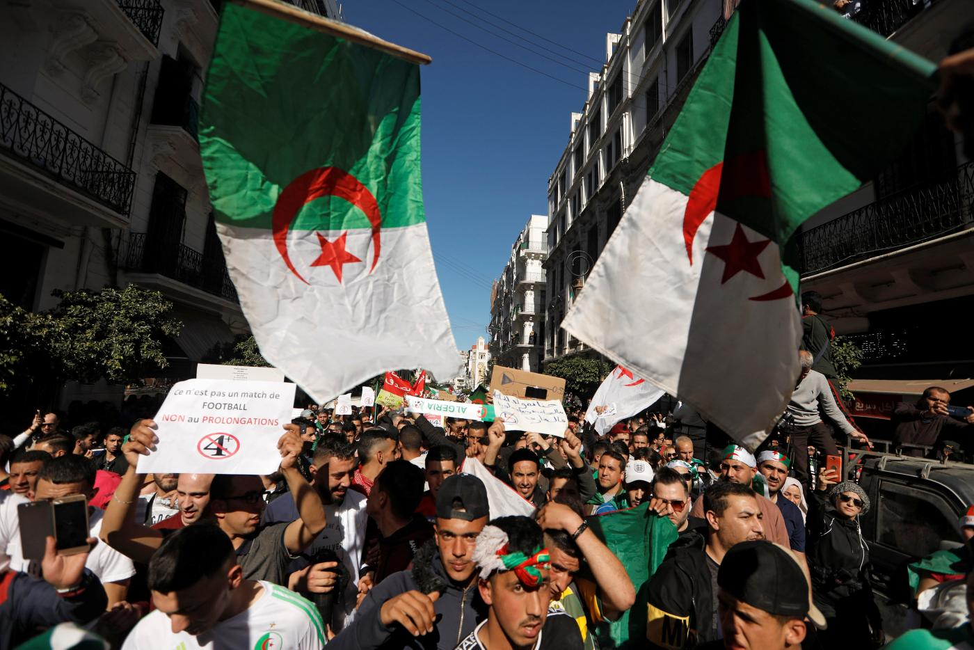 Thousands of people take part in anti-government protests in Algiers (AFP)