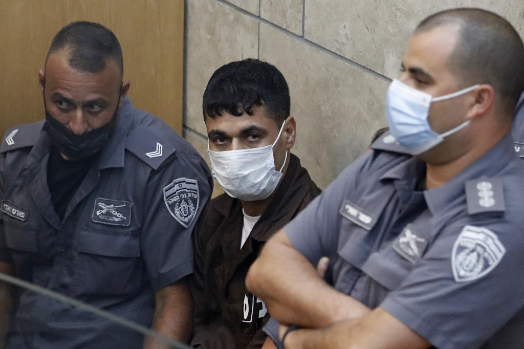 Mahmoud al-Ardah, a Palestinian prisoner who directed and oversaw the plan to dig a tunnel and jailbreak from Gilboa, is seen sitting in an Israeli court in Nazareth, 11 September 2021 (AFP)