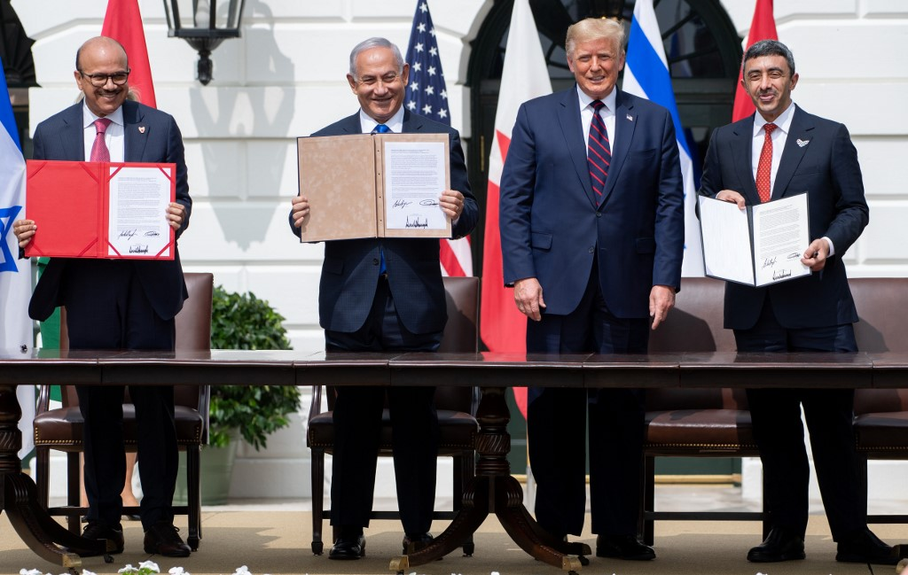 Bahraini Foreign Minister Abdullatif al-Zayani, Israeli Prime Minister Benjamin Netanyahu, US President Donald Trump and UAE Foreign Minister Abdullah bin Zayed sign the Abraham Accords in 2020 (AFP)