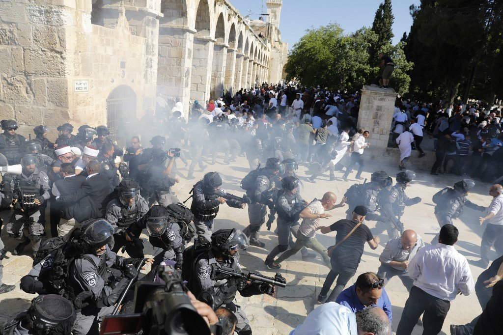 Israeli forces broke up the festival atmosphere inside Al-Aqsa as hundreds gathered for Eid prayers (AFP)
