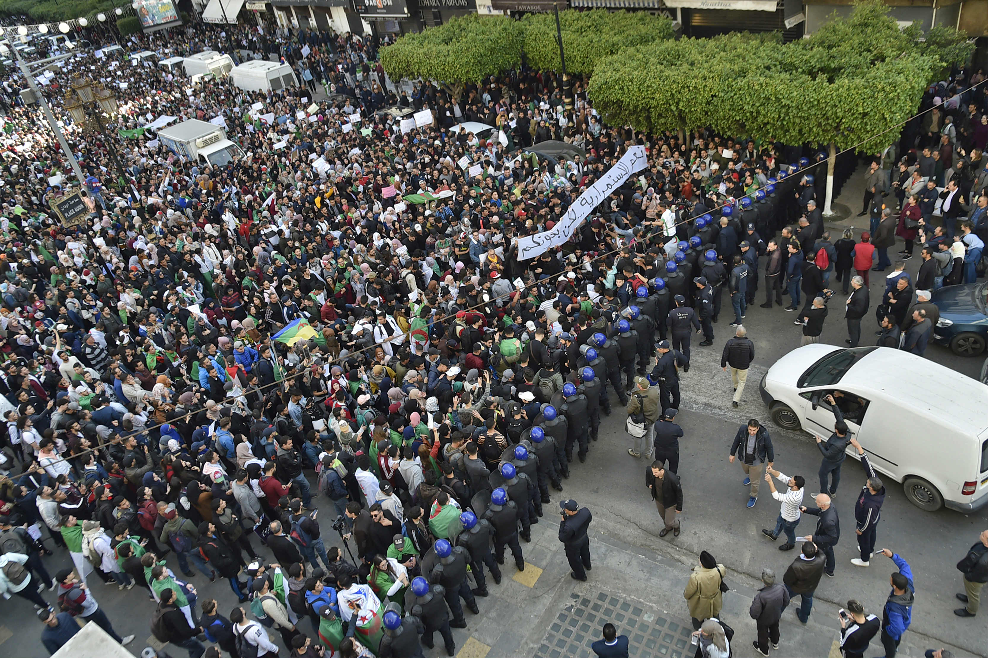 Thousands of people have taken to the streets of the capital Algiers (AFP)