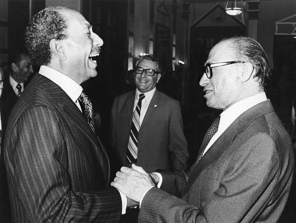 Former Egyptian President Anwar Sadat shakes hands with former Israeli Prime Minister Menachem Begin in 1977, a year before the Camp David Accords were signed (AFP)