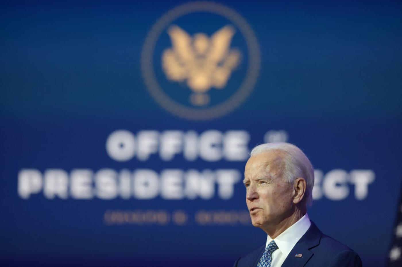 US president-elect Joe Biden speaks to the media in Delaware on 9 November (AFP)