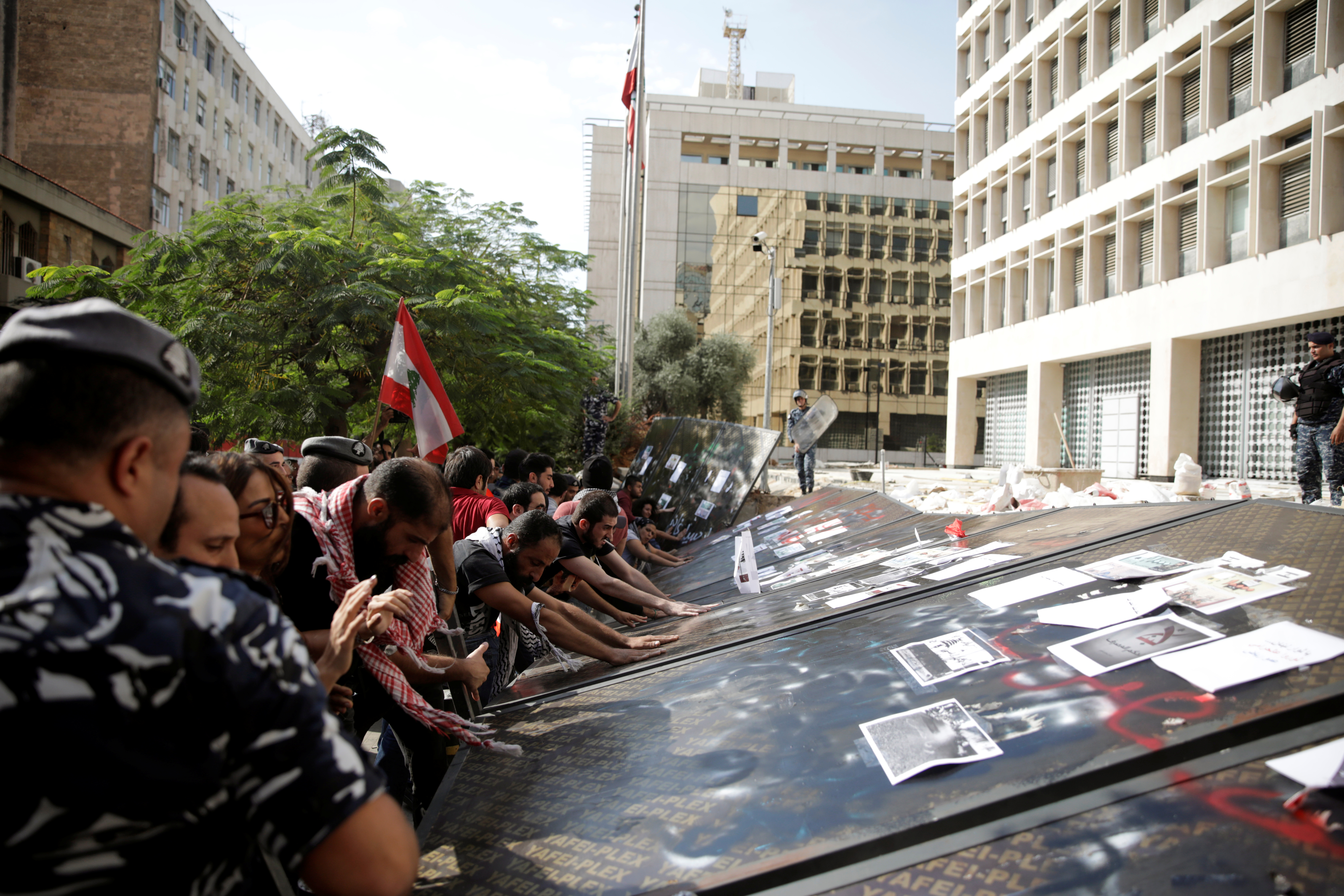 Protesters gather outside Lebanon's central bank in Beirut in 2019 (Reuters)