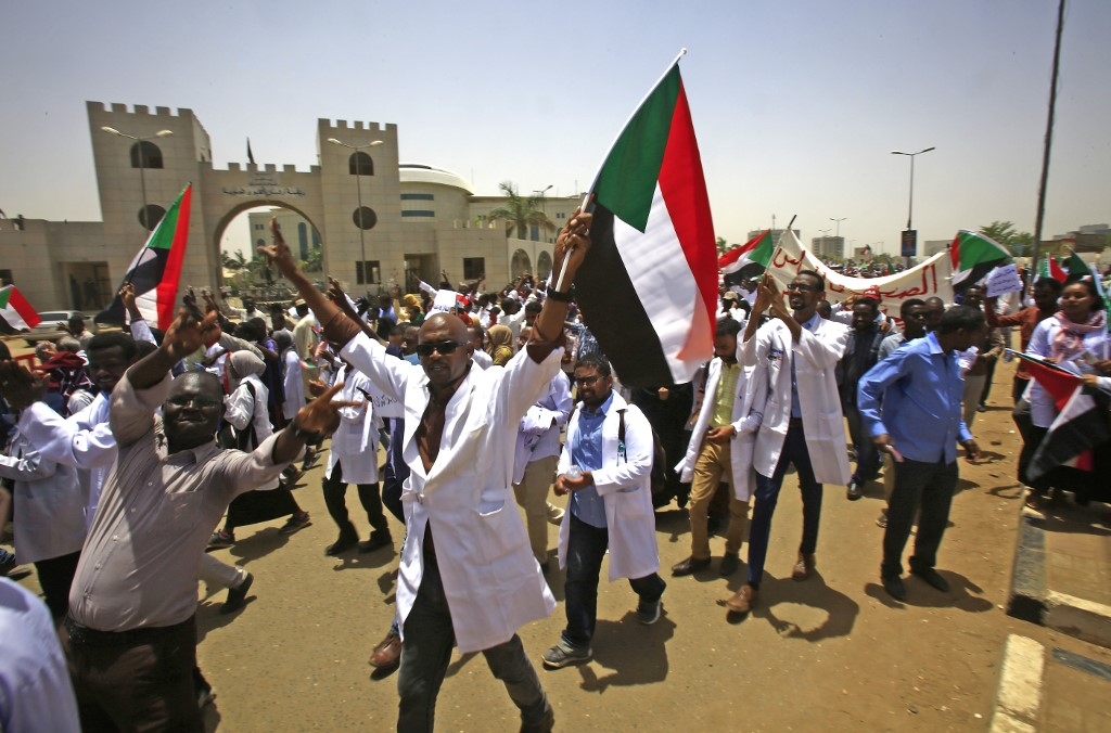 Sudanese protesters demonstrate in Khartoum on 17 April (AFP)