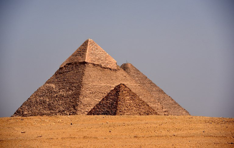 Tourists throng Egypt pyramids after bombing, but locals concerned about future