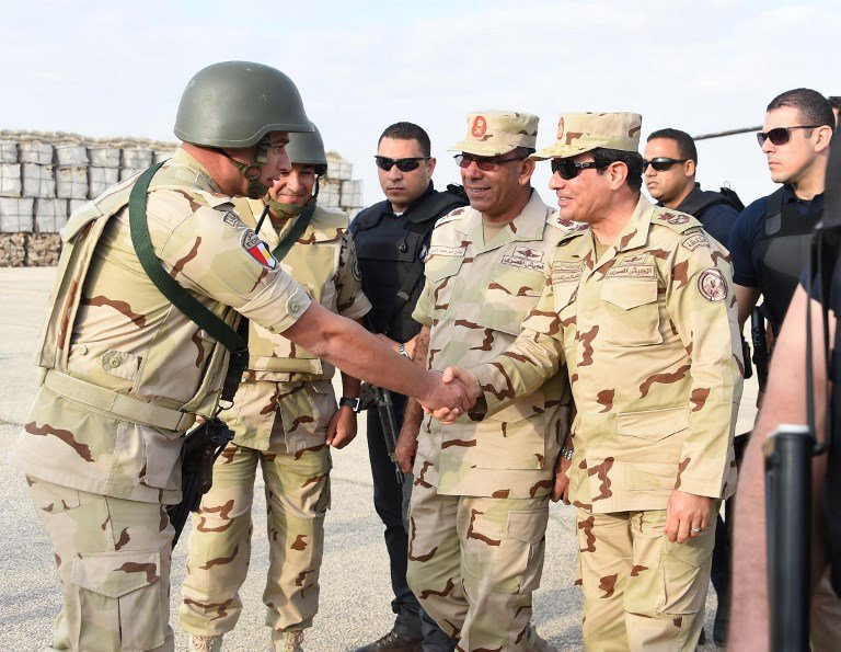 Sisi shakes hands with Egyptian security force members in July 2015 in Sinai after a wave of deadly attacks (AFP)