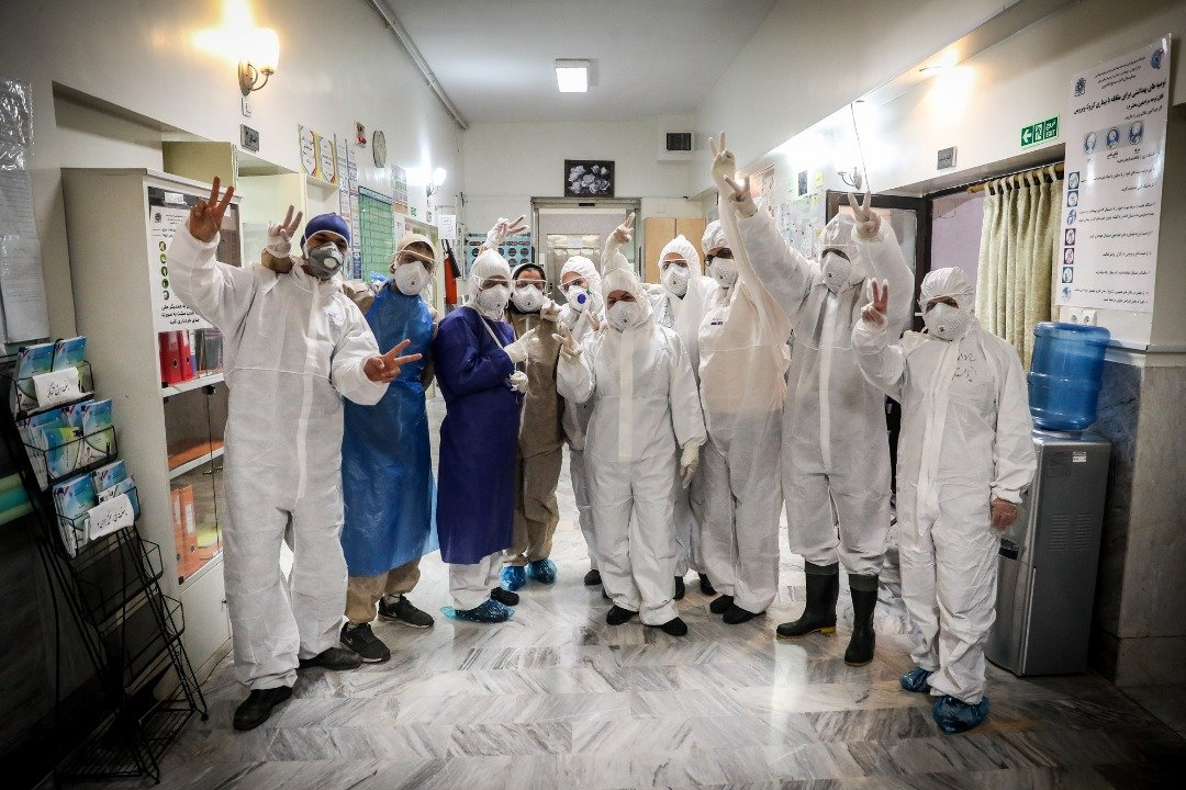 Nurses and doctors in the special unit for Covid-19 patients in Masih Daneshvari Hospital pose for a photo (MEE/Mohammadreza Abbassi)