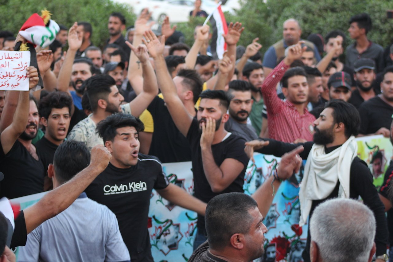 Protesters demonstrate in Basra in September 2018 (MEE/Alex MacDonald)