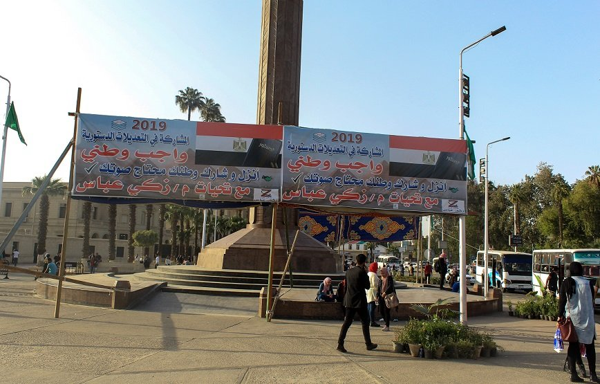 'Participation in the referendum is a national duty. Go and participate. Your country needs your voice. With greetings from Zaki Abbas,' says another poster in Cairo (MEE)