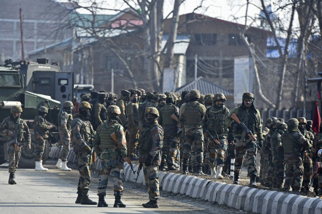 Indian soldiers are pictured on the outskirts of Srinagar on 30 December 2020 (AFP)