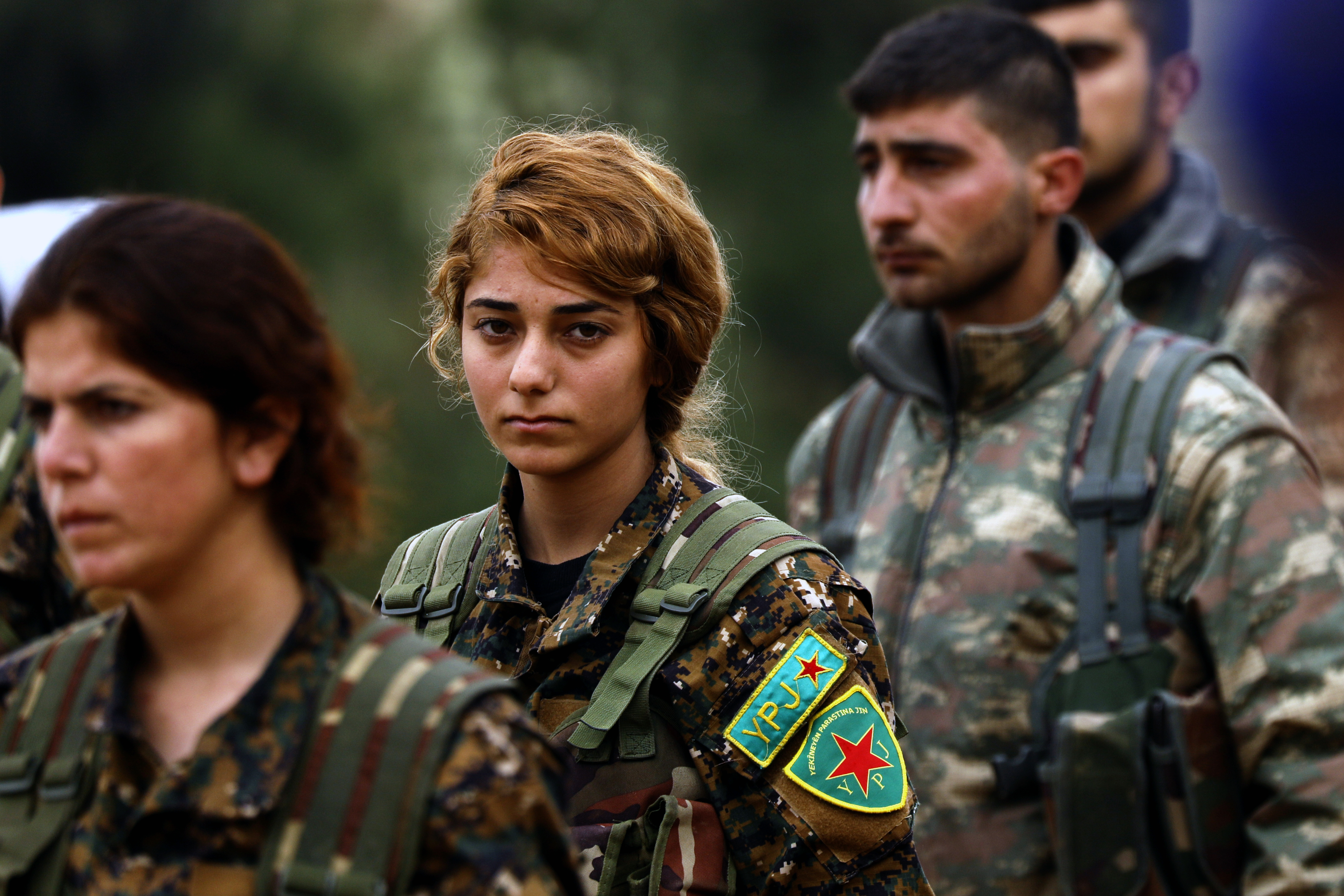 Fighters from the Kurdish women's protection units (YPJ) attend the funeral of a fellow fighter, who was killed while fighting against the Islamic State (IS), in northeastern Syrian Kurdish-majority city of Qamishli (AFP)