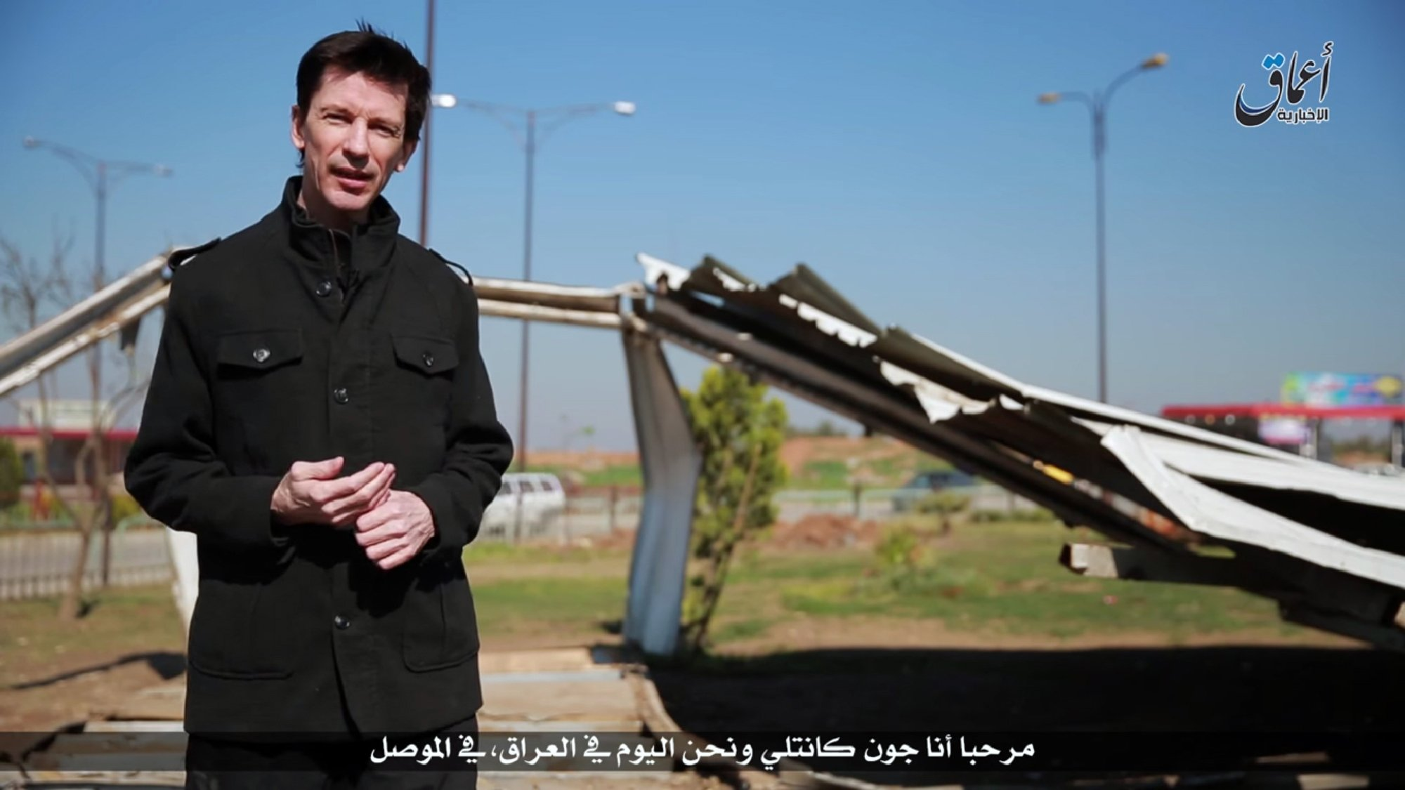 An image grab taken from a video uploaded on March 19, 2016 by Amaq News Agency, a Youtube channel which posts videos from areas under the Islamic State (IS) group's control, shows British journalist John Cantlie, who is being held prisoner by IS, speaking to the camera in the style of a news report supposedly filmed in the militants' northern Iraqi stronghold of Mosul (AFP)