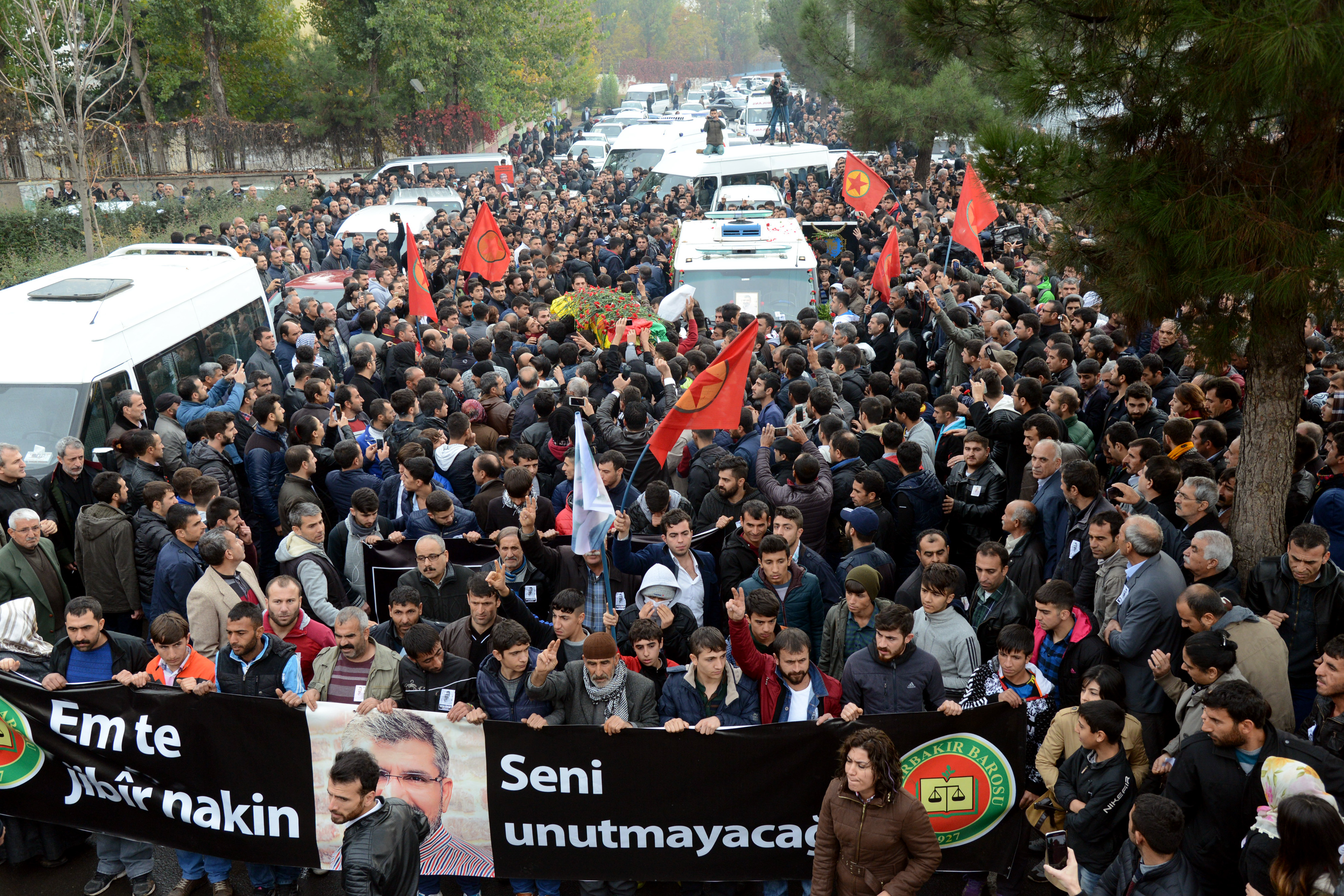 People carry the coffin of killed Kurdish Lawyer Tahir Elci during his funeral the day after his assassination in Diyarbakir (AFP)