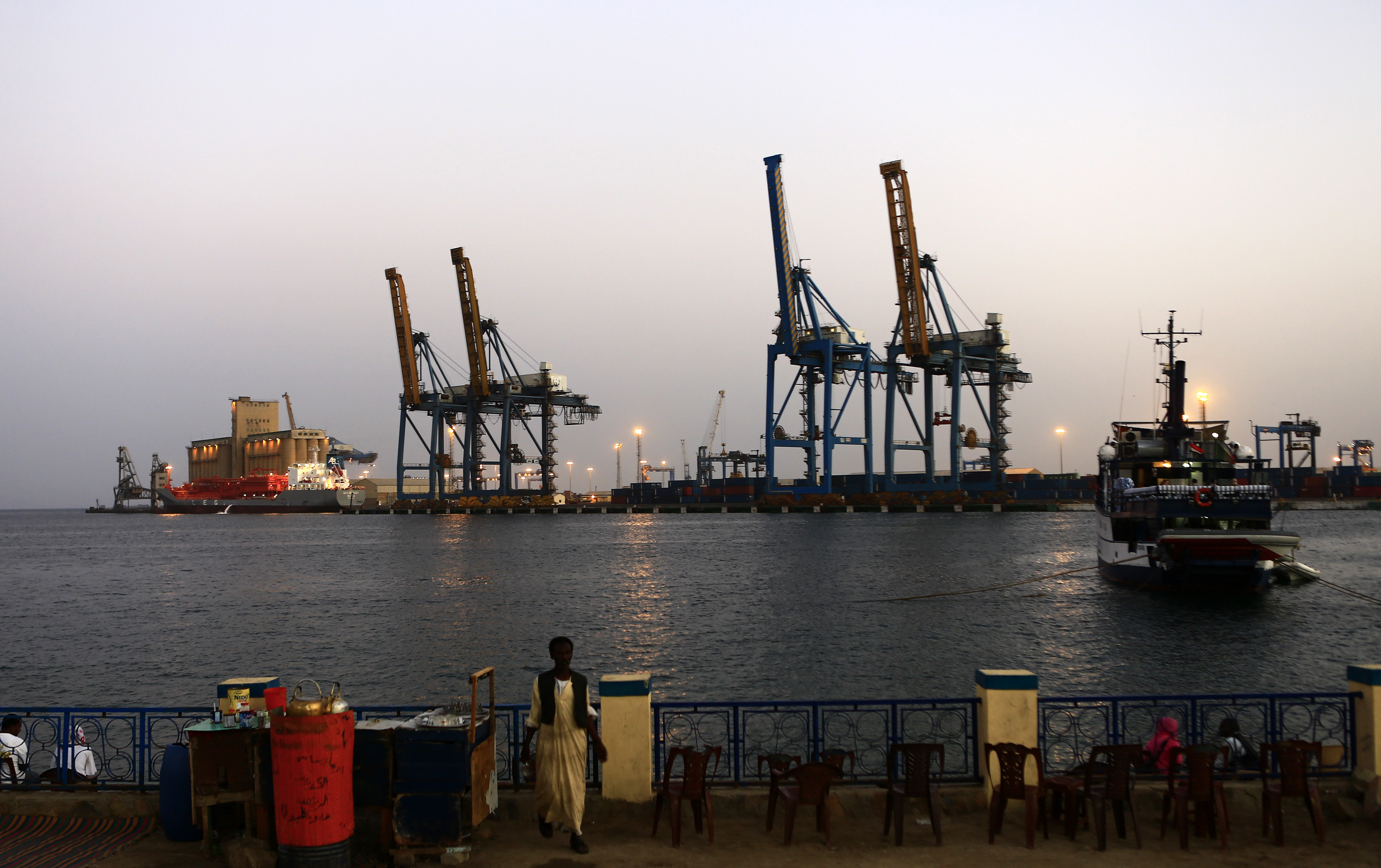 A man stands opposite the modern port at the harbour in Port Sudan (Reuters)
