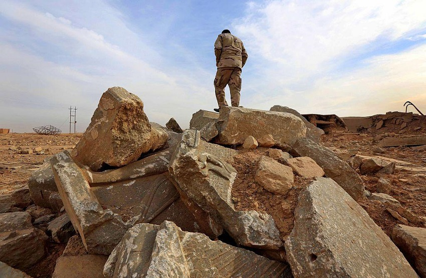 An Iraqi soldier stands among the ruins of Nimrud, pictured on 15 November (AFP)