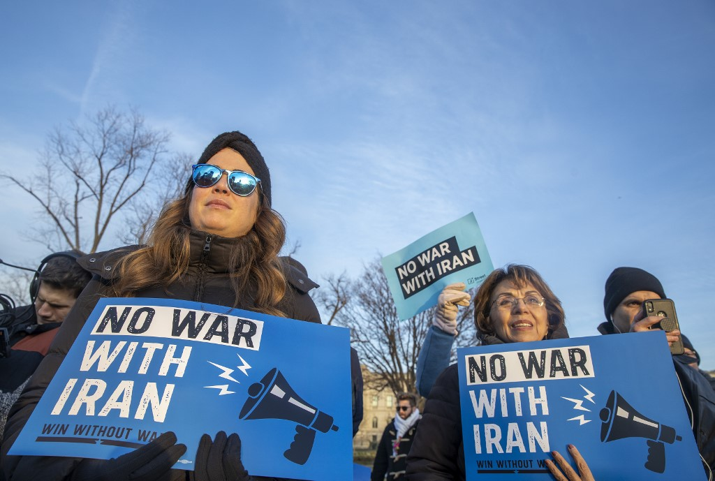 Protesters warn against war with Iran in Washington on 9 January (AFP)