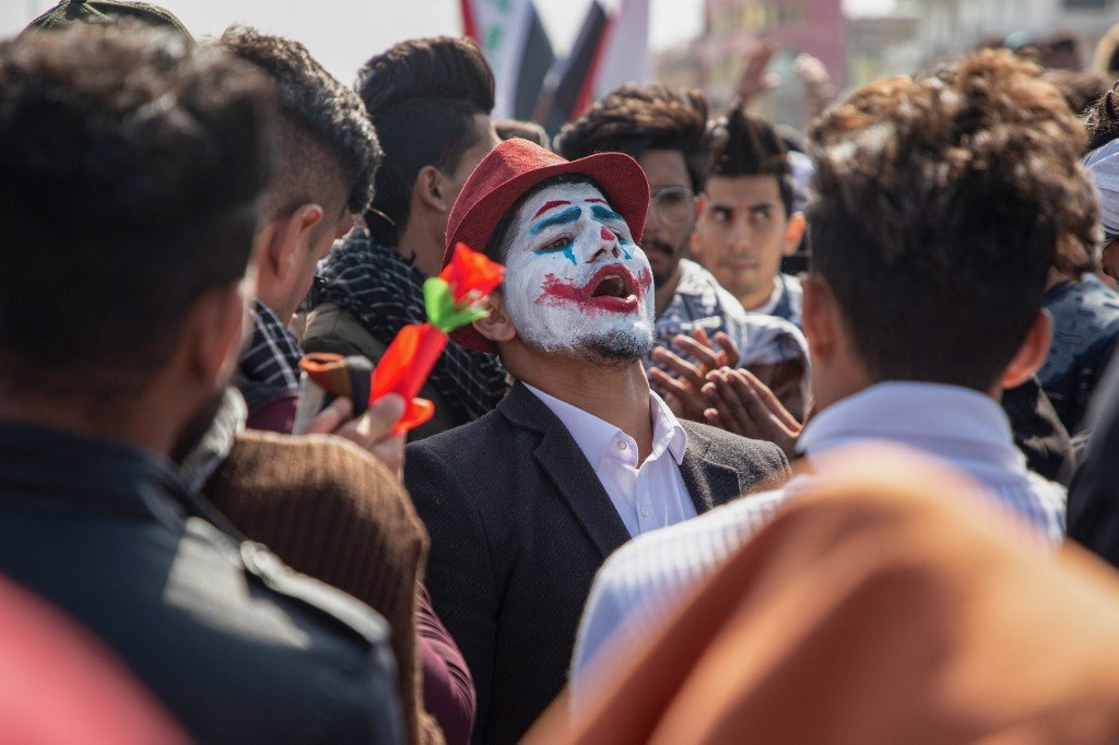 An Iraqi demonstrator dressed in a Joker outfit attends an anti-government protest in the southern city of Basra on 11 February (AFP)
