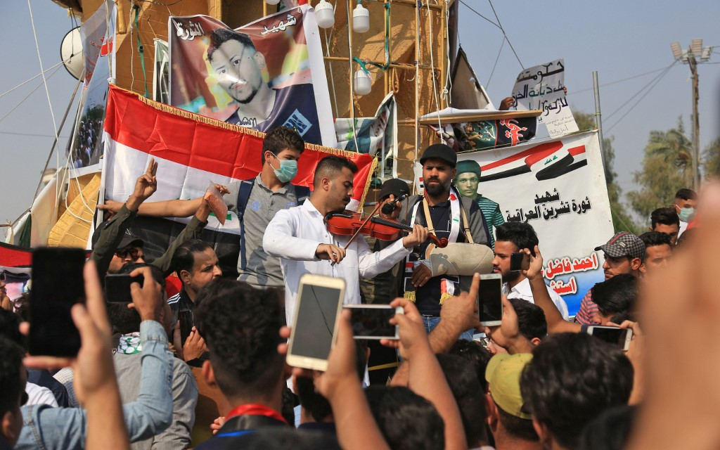 Iraqis take part in anti-government demonstrations in Karbala on 12 November (AFP)
