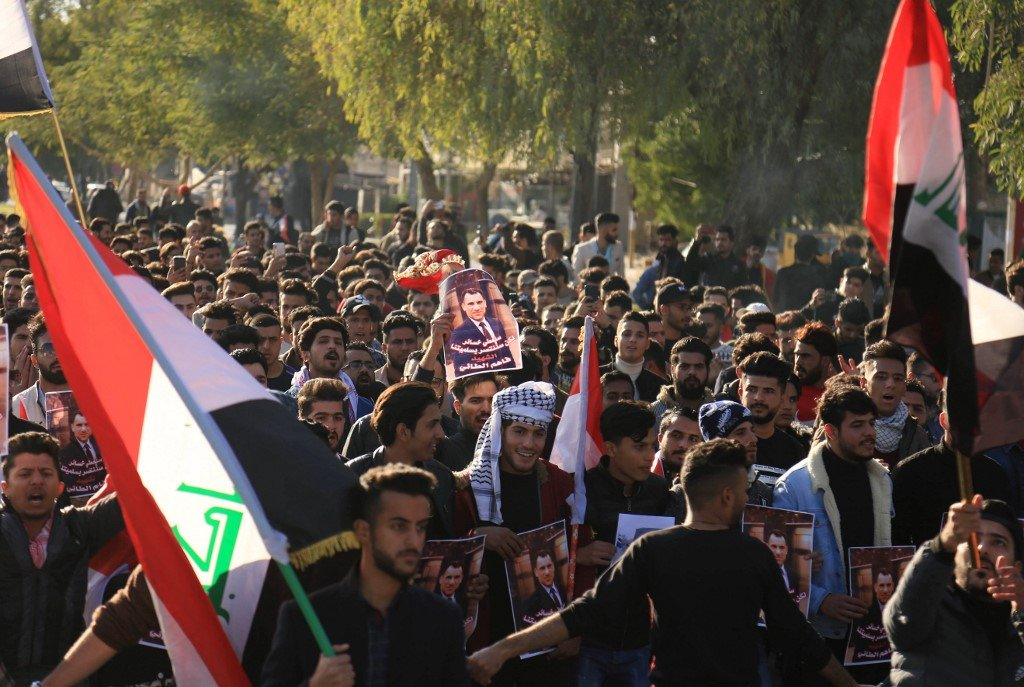 Iraqi anti-government demonstrators protest in Karbala on 10 January