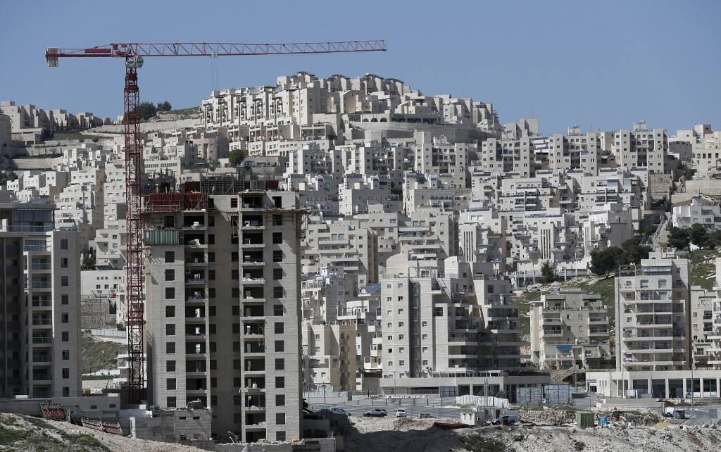 Buildings under construction are pictured in the Israeli settlement of Har Homa in occupied East Jerusalem in 2016 (AFP)