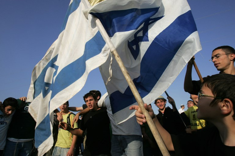 Israeli activists hold a pro-settlement demonstration in 2007 (AFP)