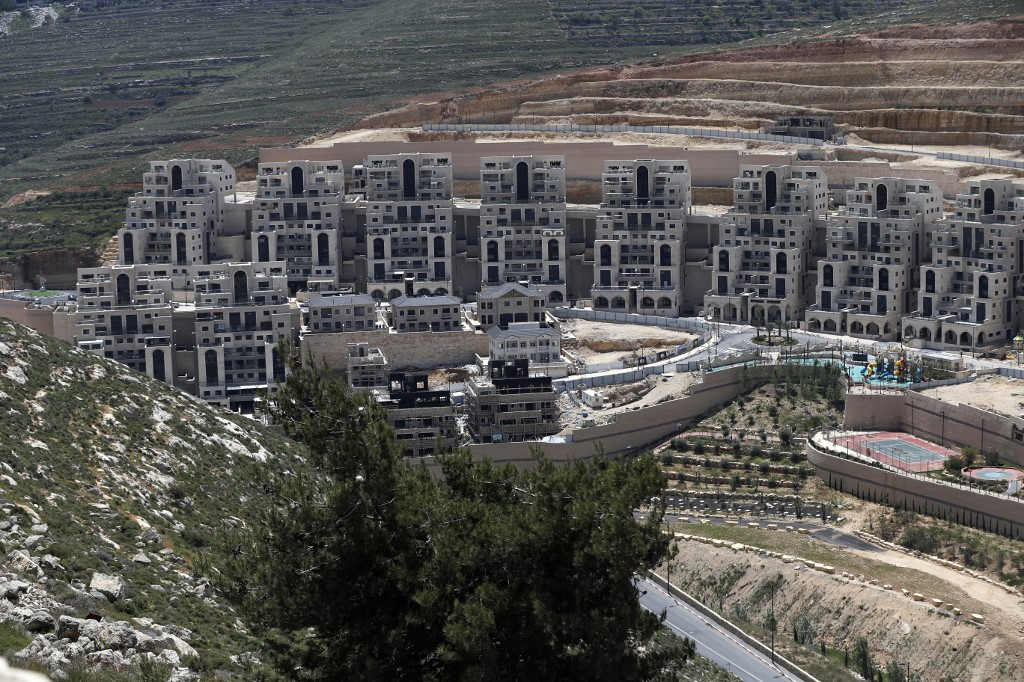 Construction takes place in the Israeli settlement of Givat Zeev on 19 April (AFP)