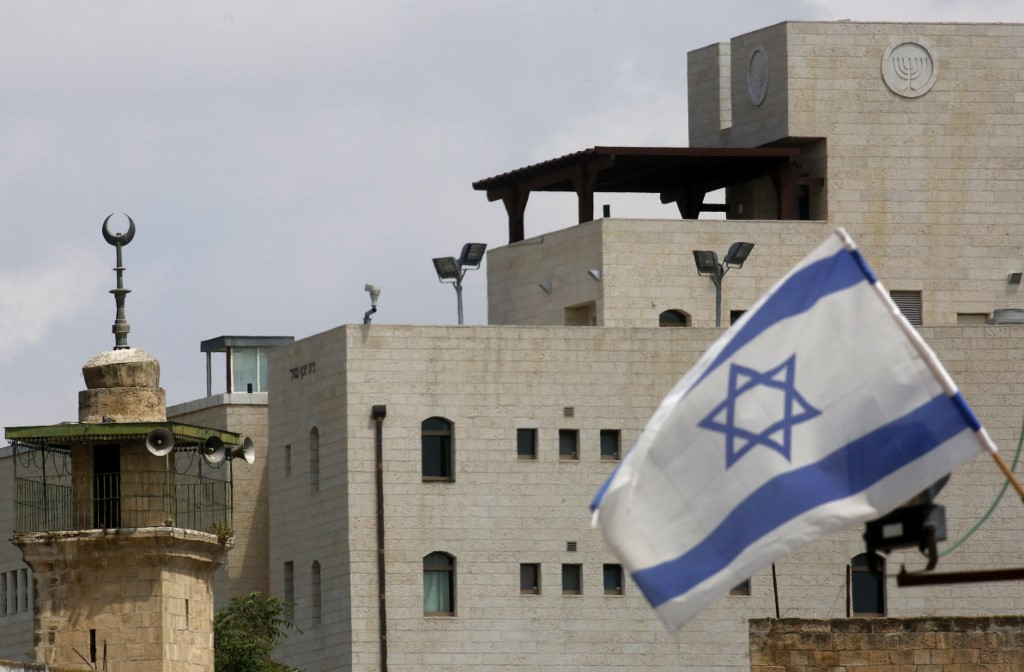 An Israeli flag is pictured at an Israeli settlement in Hebron on 14 June (AFP)