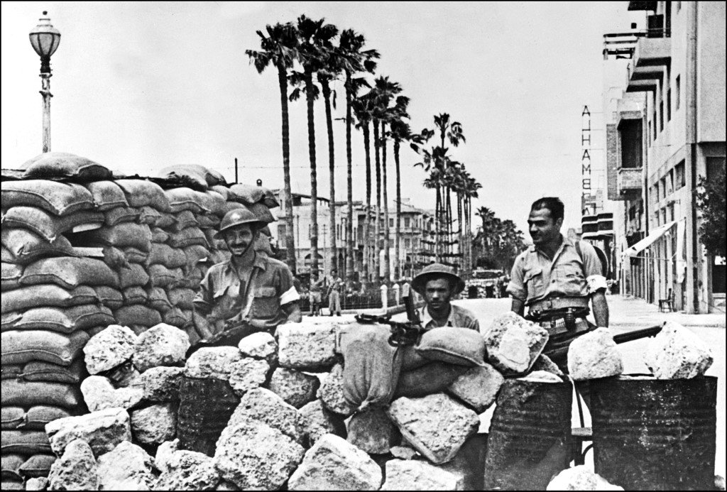 Members of the Haganah, the Jewish Agency force, stand guard in Jaffa in May 1948 (AFP)