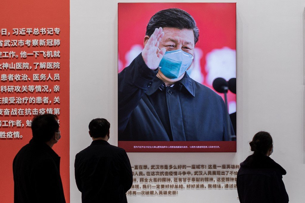 A picture of Chinese President Xi Jinping is displayed at an exhibition about China's fight against Covid-19 in Wuhan on 15 January 2021 (AFP)