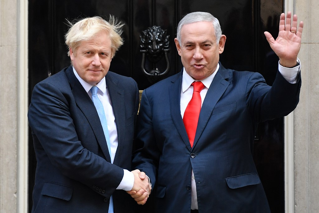 British Prime Minister Boris Johnson greets Israeli Prime Minister Benjamin Netanyahu in London on 5 September (AFP)
