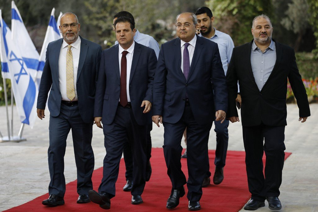 Joint List members arrive to meet Israel's president in Jerusalem on 22 September (AFP)