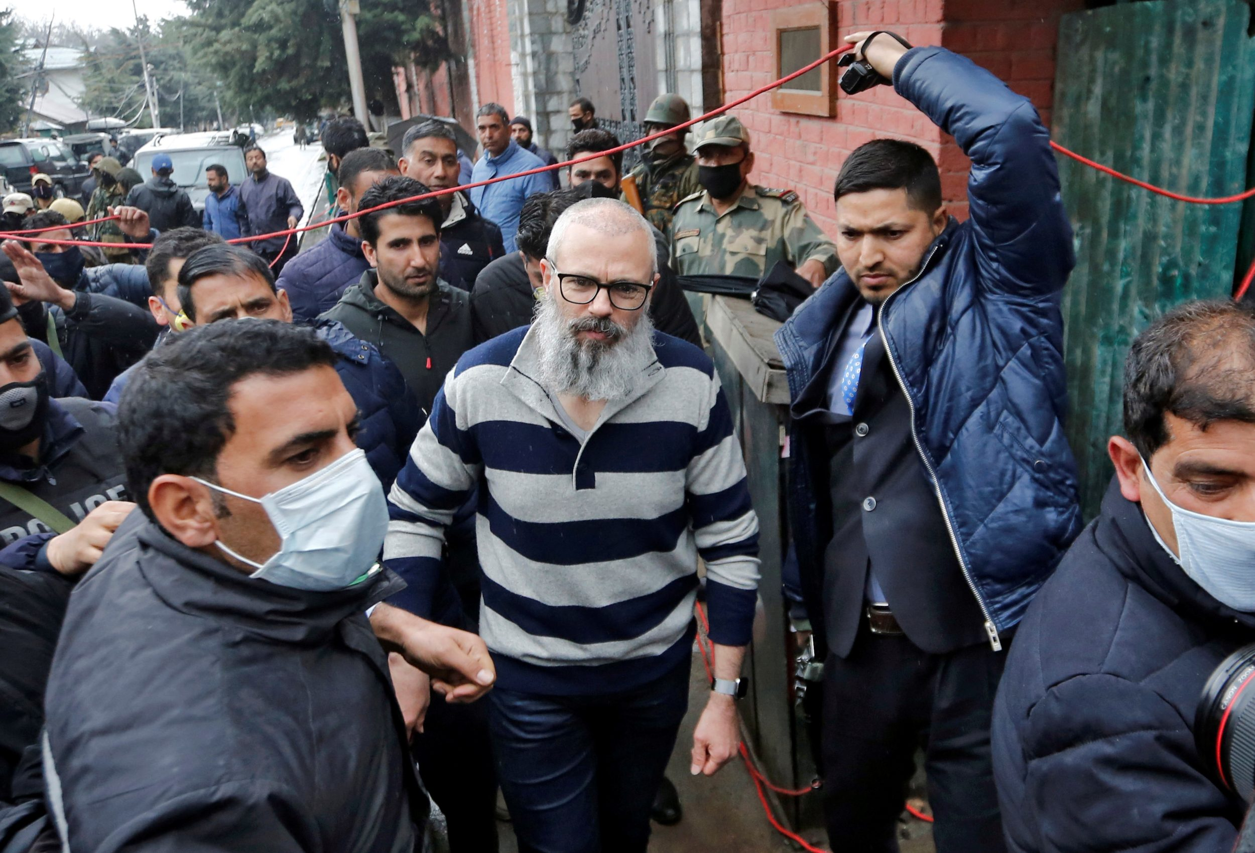 Omar Abdullah, former chief minister of Jammu and Kashmir, walks outside his residence following his release in Srinagar on 24 March 2020. He had been detained by Indian forces since August (Reuters)