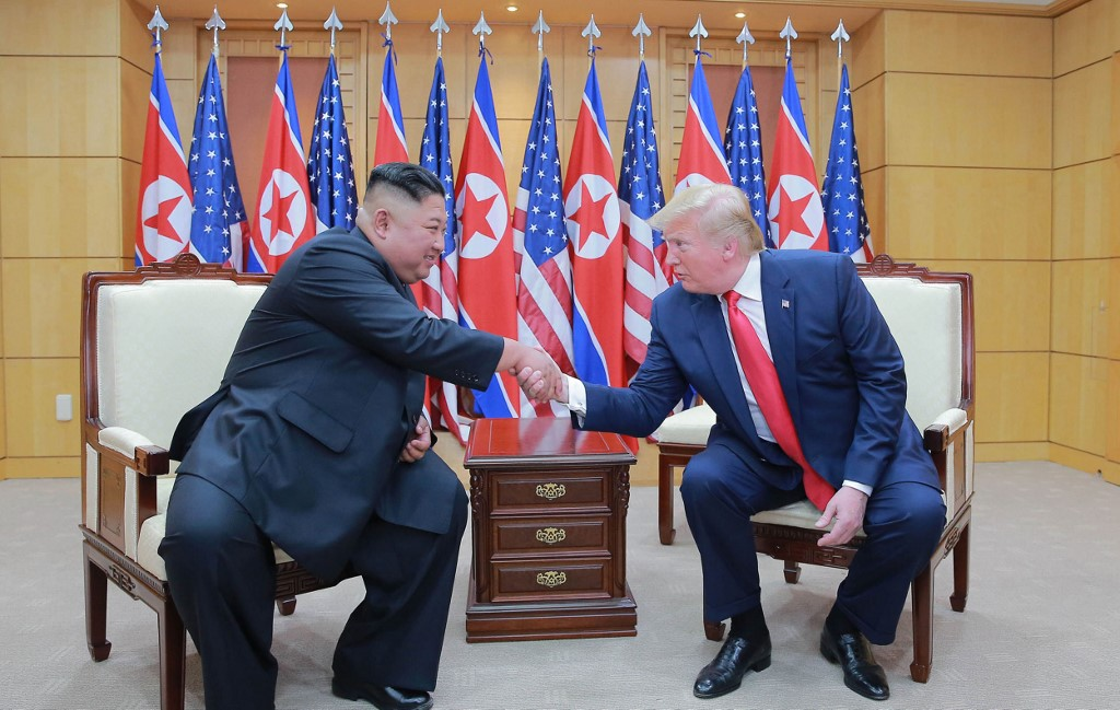 North Korean leader Kim Jong Un and US President Donald Trump shake hands during a meeting in the DMZ on 30 June (KCNA VIA KNS/AFP)