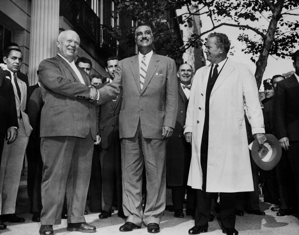 Soviet leader Nikita Khrushchev (L) shakes hand with President of Egypt Gamal Abdel Nasser (C) as President of Yugoslavia Josip Tito looks on outside the UN headquarters in New York, 1960 (AFP)